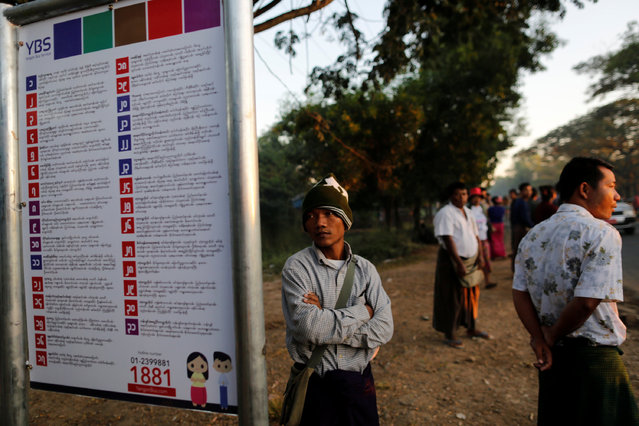 A man looks at a sign showing the bus routes for a new transport system at a bus stop in Yangon, Myanmar January 16, 2017. (Photo by Soe Zeya Tun/Reuters)