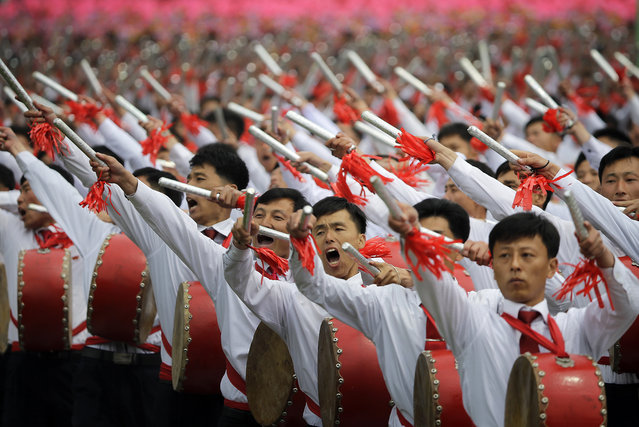 Parade participants beat drums as they march on the Kim Il Sung Square on Tuesday, May 10, 2016, in Pyongyang, North Korea. (Photo by Wong Maye-E/AP Photo)