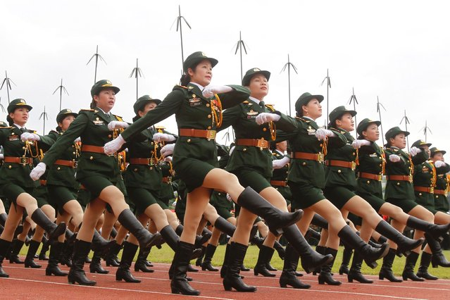 Vietnamese female soldiers from a communication unit march during the 60th anniversary celebrations of the Dien Bien Phu battle in the historic city, on 07 May 2014. (Photo by Reuters/Kham)