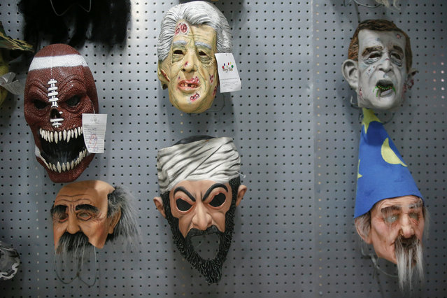 Masks are displayed in the showroom of Jinhua Partytime Latex Art and Crafts Factory in Jinhua, Zhejiang Province, China, May 25, 2016. (Photo by Aly Song/Reuters)