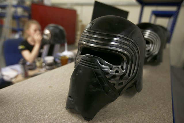 "A completed replica of Kylo Ren's helmet from ""Star Wars: The Force Awakens"", sits on a shelf in the Propshop headquarters at Pinewood Studios near London, Britain May 25, 2016. (Photo by Peter Nicholls/Reuters)"