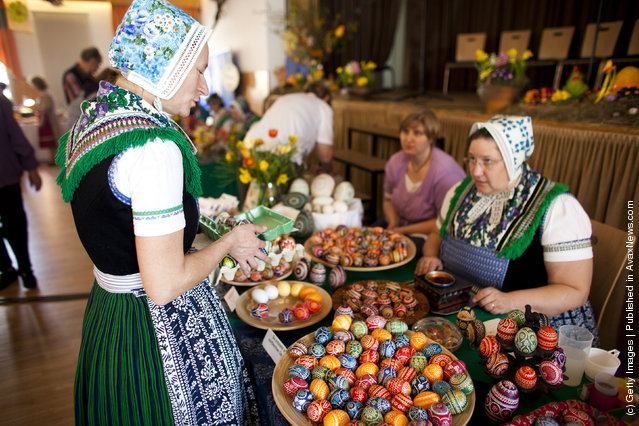 Women, wearing a traditional Lusatian sorbian folk dress, talk at the annual Sorbian Easter egg market