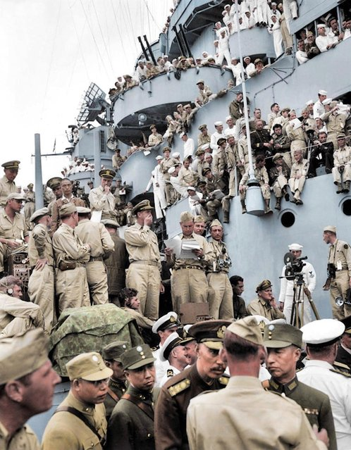 Spectators from all over the world pick vantage positions on the deck of the USS Missouri, in Tokyo Bay, to watch the Japanese surrender ceremony marking the end of World War II, September 1945. (Photo by Royston Leonard/Mediadrumworld)