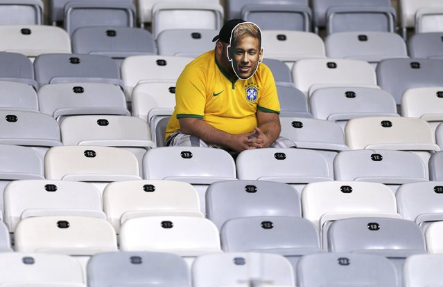 A fan dressed as Brazil's Neymar sits in an empty stand after the 2014 World Cup semi-finals between Brazil and Germany at the Mineirao stadium in Belo Horizonte July 8, 2014. (Photo by Marcos Brindicci/Reuters)