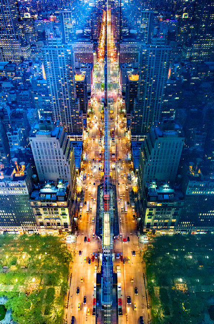 """Donna Dotan has a self-described obsession with symmetry. Her prowess with architectural photography is well applied in her personal project, """"Reflections from Above"""", where she captures striking images of New York City reflected in the glass of skyscrapers. She describes the project as a treasure hunt, and says that she is looking for an all-glass skyscraper to add more reflections to her series. (Photo by Donna Dotan)"""