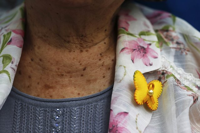 """South Korean former """"comfort woman"""" Gil Won-ok wears a badge in the shape of the butterfly during the weekly Wednesday protest demanding for an apology and compensation from the Japanese government in Seoul, South Korea, July 22, 2015. The butterfly is a symbol of the Butterfly Fund, which helps women across the world affected by wartime sexual violence. (Photo by Kim Kyung-Hoon/Reuters)"""