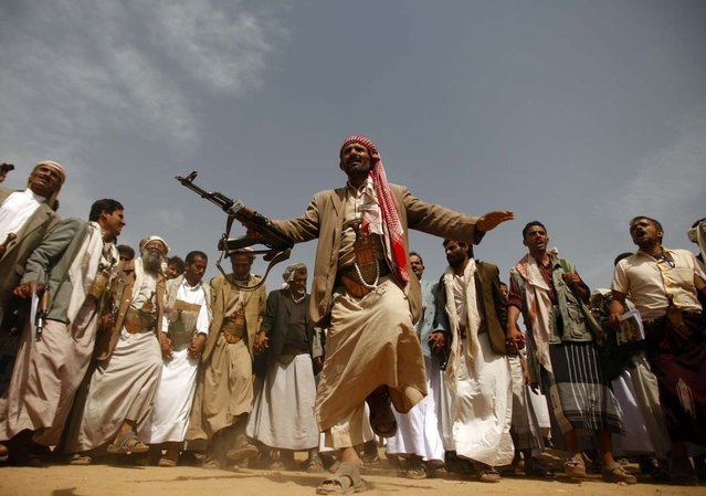 A tribesman, loyal to the al-Houthi Shi'ite rebel group, performs a traditional dance at the conclusion of a two-day tribal gathering in the northwestern Yemeni province of Saada, on the border with Saudi Arabia on July 12, 2012