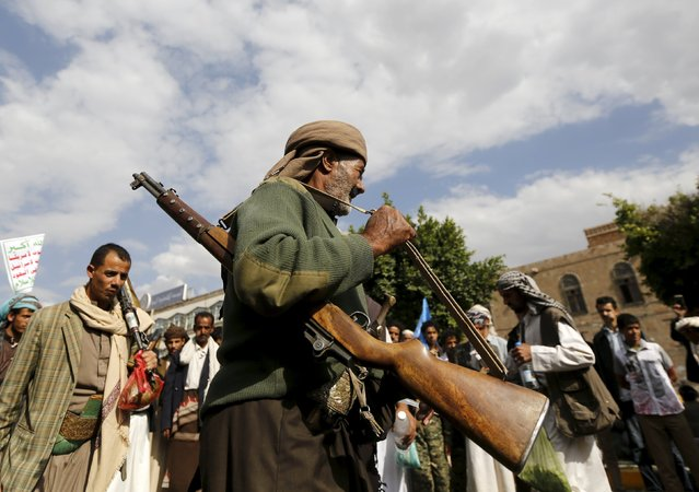 A Houthi follower carries his weapon as he performs the traditional Baraa dance ahead of a demonstration against the Saudi-led air strikes in Yemen's capital Sanaa August 24, 2015. (Photo by Khaled Abdullah/Reuters)