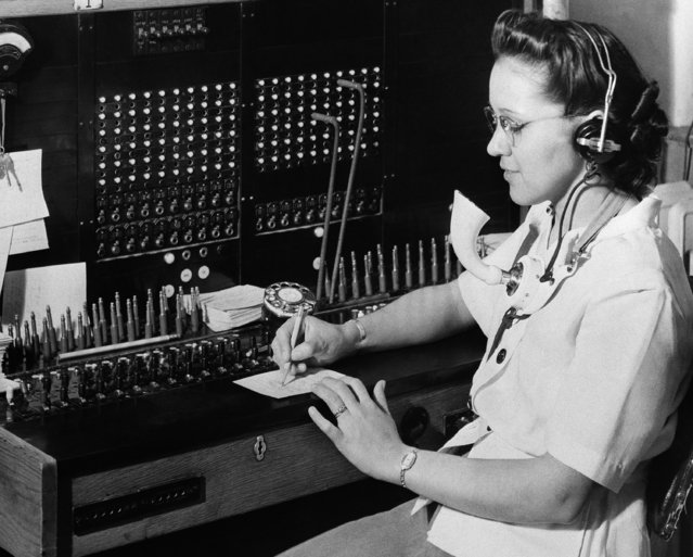 Margaret Morgan, a Navajo, is shown at her job as a switchboard operator in Window Rock, Ariz., June 3, 1945. (Photo by AP Photo)