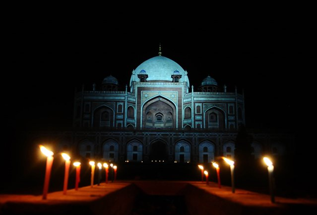 Archaeological Survey of India (ASI) candle lighting for World Heritage Day and in solidarity with doctors dealing with coronavirus at Humayuns Tomb in New Delhi, India on April 18, 2020. (Photo by Imtiyaz Khan/Anadolu Agency via Getty Images)