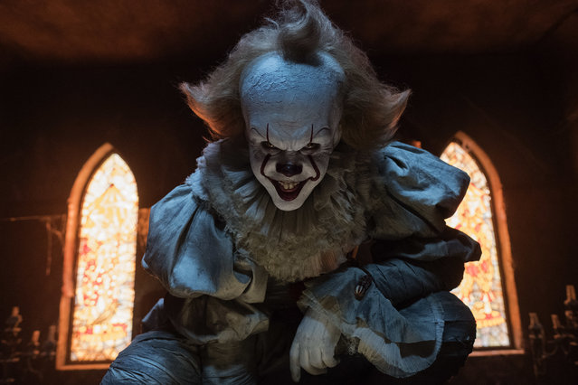 "This image released by Warner Bros. Pictures shows Bill Skarsgard in a scene from ""It"". (Photo by Brooke Palmer/Warner Bros. Pictures via AP Photo)"