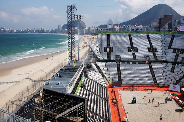 Beach volleyball players practice on center court of the beach volleyball arena along Copacabana Beach ahead of the upcoming 2016 Summer Olympics in Rio de Janeiro, Brazil, Tuesday, August 2, 2016. (Photo by David Goldman/AP Photo)