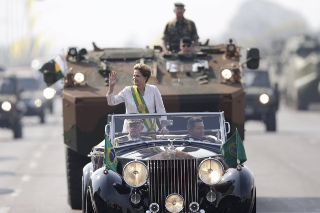 Brazil's President Dilma Rousseff waves in a vehicle during a civic-military parade to commemorate Brazil's Independence Day in Brasilia, Brazil September 7, 2015. (Photo by Ueslei Marcelino/Reuters)