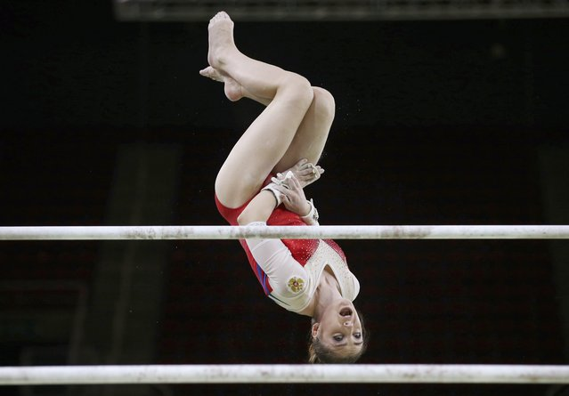 2016 Rio Olympics, Gymnastics training, Rio Olympic Arena, Rio de Janeiro, Brazil on August 4, 2016. Aliya Mustafina (RUS) of Russia trains on the uneven bars. (Photo by Damir Sagolj/Reuters)
