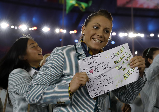 An Australian athlete holds up a sign as the Australia team arrive during the opening ceremony for the 2016 Summer Olympics in Rio de Janeiro, Brazil, Friday, August 5, 2016. (Photo by David J. Phillip/AP Photo)