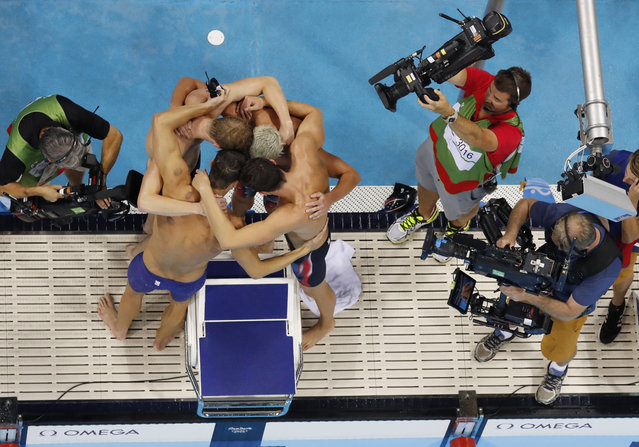 The United States 4 x 200m freestyle relay team celebrates after winning a gold medal during to the swimming competitions at the 2016 Summer Olympics, Tuesday, August 9, 2016, in Rio de Janeiro, Brazil. (Photo by Morry Gash/AP Photo)