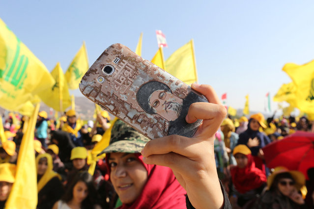 A Hezbollah supporter shows off a picture of Lebanon's Hezbollah leader Sayyed Hassan Nasrallah on her phone during a rally marking the 10th anniversary of the end of Hezbollah's 2006 war with Israel, in Bint Jbeil, southern Lebanon August 13, 2016. (Photo by Aziz Taher/Reuters)