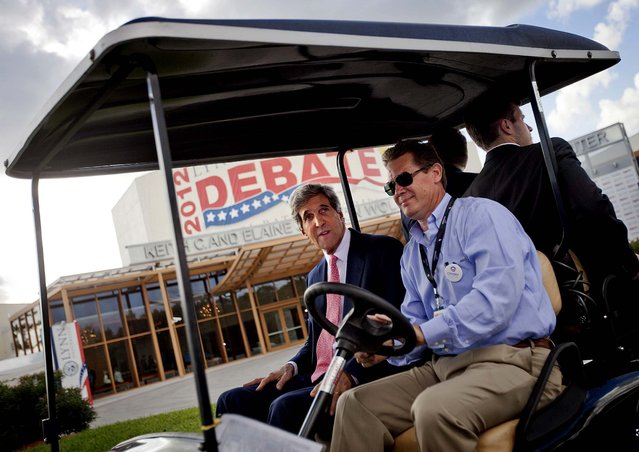 Sen. John Kerry, D-Mass rides in a golf cart after giving an interview in front of the debate hall Monday afternoon. (Photo by David Goldman/Associated Press)