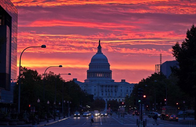 The sun rises over the Capitol in Washington, D.C.,  October 15, 2012. (Photo by J. Scott Applewhite/Associated Press)