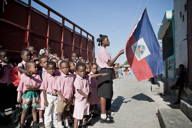 Port-au-Prince, Haiti. Pont-Rouge, Zephyr school, raising of the national colors in November 2003. (Photo by Jean-Claude Coutausse)