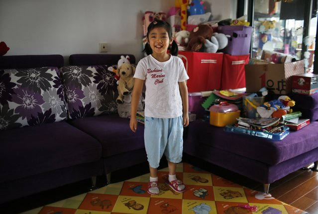 "Only child Liu Ziyu, who was born in 2009, poses for a photograph in Shanghai August 30, 2014.  When asked if she would like to have siblings, Ziyu said that she didn't want any ""because my mother would pay full attention to him or her"". (Photo by Carlos Barria/Reuters)"