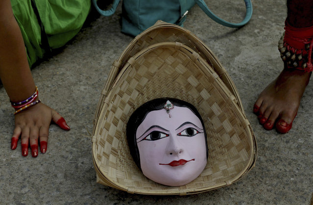 A traditional handmade mask is kept in a bamboo basket as cultural artists from India's Jharkhand state wait to perform at a World Tourism Day carnival in Bhubaneswar, India, Sunday, September 27, 2015. (Photo by Biswaranjan Rout/AP Photo)