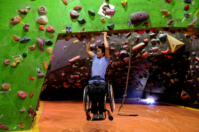 Wheelchair-bound Lai Chi-wai, the first Chinese to be nominated for Laureus World Sports, demonstrates his skill in Hong Kong, China January 5, 2018. (Photo by Bobby Yip/Reuters)