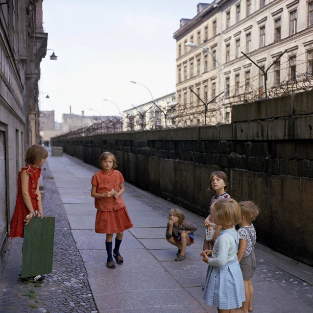 The 1968 file photo shows children playing at the Berlin Wall at divided Sebastianstrasse near Heinrich-Heine-Strasse. (Photo by AP Photo)