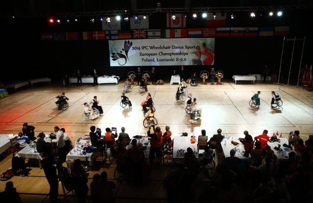 Participants compete during IPC Wheelchair Dance Sport European Championships in Lomianki near Warsaw, November 9, 2014. (Photo by Kacper Pempel/Reuters)