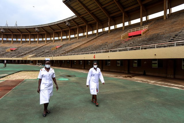 Medical workers are seen at Namboole National Stadium in the central Ugandan district of Wakiso, about 15 km east of the capital Kampala, on September 7, 2020. Uganda's ministry of health has converted parts of Namboole National Stadium into an auxiliary hospital to cater for the rapidly increasing number of COVID-19 cases in the east African country. (Photo by Hajarah Nalwadda/Xinhua News Agency)