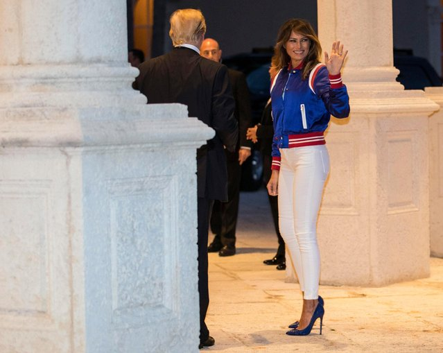 President Donald Trump and first lady Melania turn to go inside after viewing the Florida Atlantic University Marching Band at Trump International Golf Club in West Palm Beach, Fla., Sunday, February 4, 2018, after arriving for a Super Bowl party. (Photo by Carolyn Kaster/AP Photo)