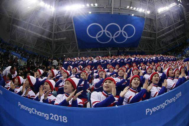 Supporters from North Korea cheer before the preliminary round of the men's hockey game between the Czech Republic and South Korea at the 2018 Winter Olympics in Gangneung, South Korea, Thursday, February 15, 2018. (Photo by rank Franklin II/AP Photo)