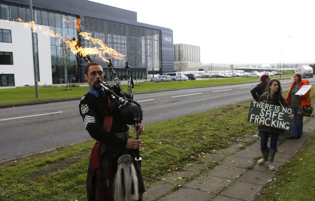 A man plays flaming bag pipes as opponents of fracking protest outside the offices of Ineos after they received the first shipment of shale gas to be delivered to the Britain at their Grangemouth  terminal in Scotland, Britain September 27, 2016. (Photo by Russell Cheyne/Reuters)