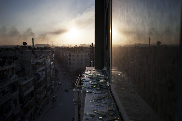 Smoke rises from a damaged building in Aleppo, Syria, Saturday, October 13, 2012. (Photo by Manu Brabo/AP Photo)