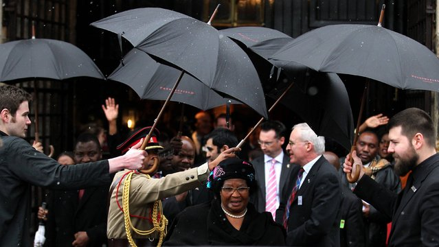 Umbrellas are held up for the President of the Republic of Malawi, Joyce Banda, as she leaves the The Scotland and Malawi: Livingstone's Living Legacy event in Edinburgh organised by Scotland Malawi Partnership, on March 18, 2013. A schoolgirl blogger and charity fundraiser has met the president of Malawi as part of a week of celebrations marking 200 years since the birth of missionary David Livingstone. Martha Payne, 10, a pupil at Lochgilphead Primary School in Argyll, has raised £129,000 for the Scotland-based charity Mary's Meals which provides food for children in Malawi. (Photo by  Andrew Milligan/PA Wire)
