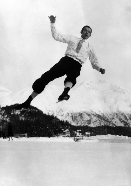 The English skating champion Graham Sharp practicing at St. Moritz, on the Palace Ice rink on January 12, 1938. His grace is well demonstrated in this picture. (Photo by AP Photo)