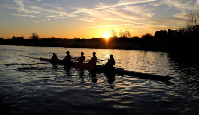 Rowers work out along the river Cam in Cambridge November 24, 2014, as much of Britain was covered with a light frost. (Photo by Chris Radburn/PA Wire)