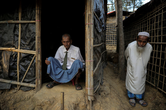 Rohingya refugee Omar Khan (L), who says he is a former general of Myanmar army, poses for a picture as he sits at his temporary shelter at the Kutupalong refugee camp near Cox's Bazar, Bangladesh December 19, 2017. (Photo by Marko Djurica/Reuters)