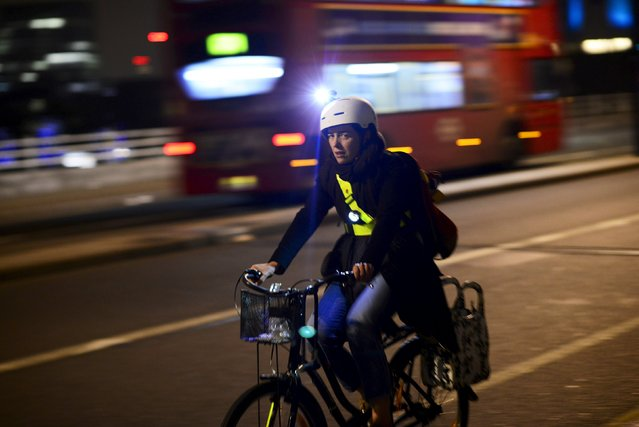A cyclists goes across Waterloo Bridge as night falls in London, Britain November 2, 2015. (Photo by Dylan Martinez/Reuters)