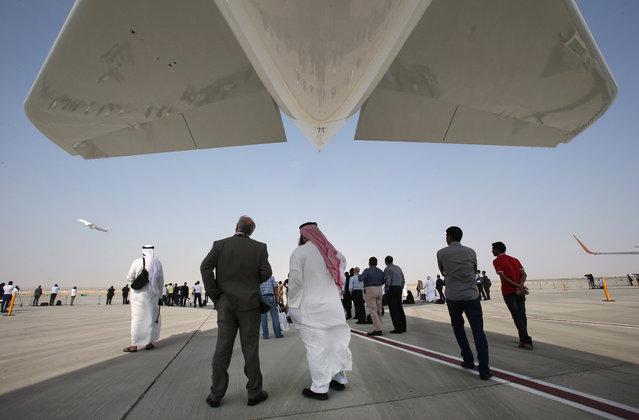 Visitors watch an Airbus A350 XWB during the opening of the Dubai Airshow in Dubai, United Arab Emirates, Sunday, November 8, 2015. (Photo by Kamran Jebreili/AP Photo)