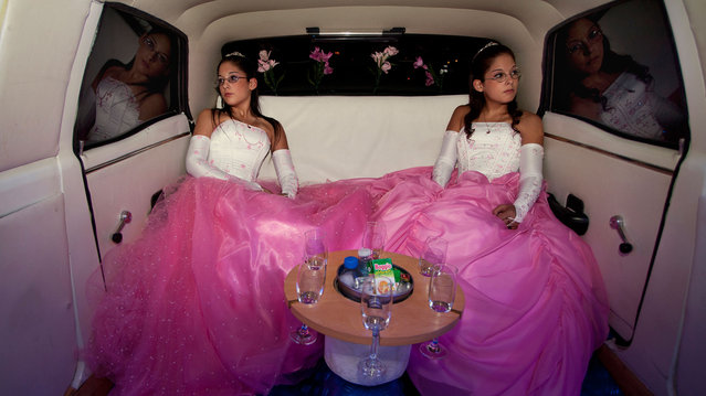 The twins Laura and Beln on the day of their fifteenth birthday celebration. In Latin America, the celebration of the fifteenth birthday of a teenager is very important because it marks the transition from childhood to maturity. (Photo by Myriam Meloni/2013 Sony World Photography Awards)