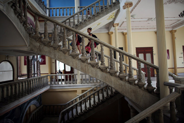 Students at the Cuba's National Ballet School (ENB) arrive for a class in Havana, Cuba, October 12, 2016. (Photo by Alexandre Meneghini/Reuters)