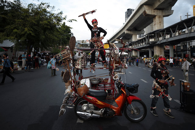 A Thai anti-government protester stands on top of a modified motorcycle as she joins a street protest calling for political and monarchical reform in Bangkok, Thailand, 02 December 2020. Thailand has been facing political turmoil amid months-long street protests calling for the political and monarchical reform and the resignation of the prime minister Prayuth Chan-ocha who earlier in the day was acquitted of violating the constitution by continuing to live in the army house despite of his retirement as army commander in September 2014. (Photo by Diego Azubel/EPA/EFE)