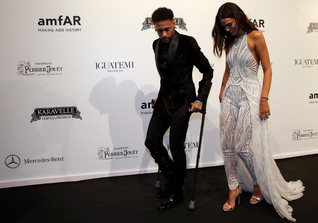 Soccer player Neymar and his girlfriend Bruna Marquezine arrive at the eighth annual amfAR Gala Sao Paulo in Sao Paulo, Brazil April 13, 2018. (Photo by Paulo Whitaker/Reuters)
