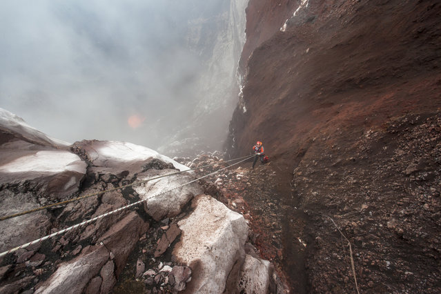 Intrepid explorers descend into the Marum Volcano in Vanuatu. (Photo by Bradley Ambrose/Caters News)