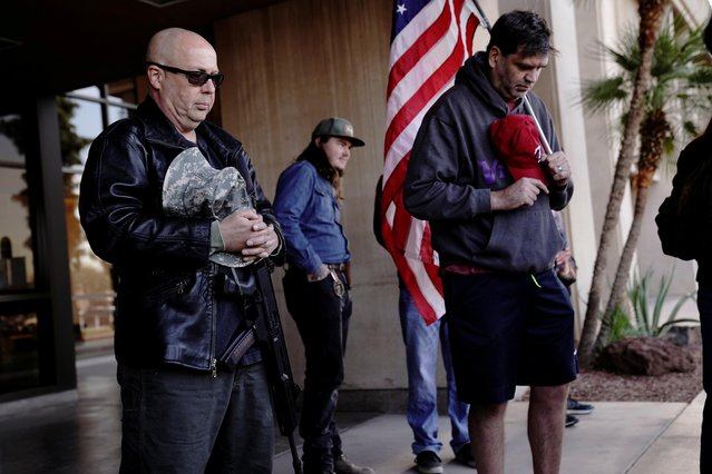 Protestors pray outside as Arizona electors gather to cast their votes for the U.S. presidential election, at the Arizona Capitol, in Phoenix, Arizona, U.S., December 14, 2020. (Photo by Cheney Orr/Reuters)