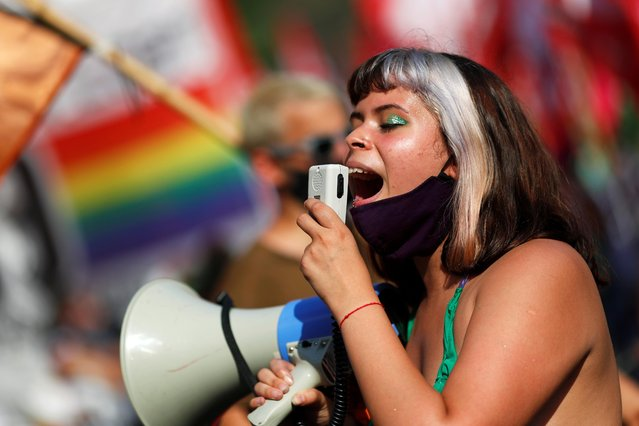 A woman uses a megaphone as she protests in favour of legalizing abortion outside the National Congress in Buenos Aires, Argentina, December 29, 2020. (Photo by Agustin Marcarian/Reuters)