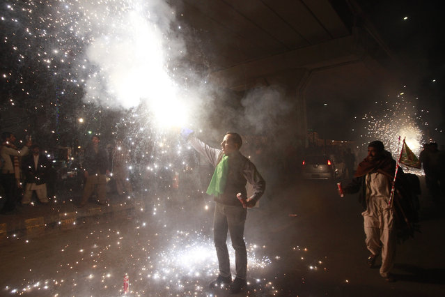 A man holds fireworks during a celebration to mark Eid-e-Milad-ul-Nabi, the birthday anniversary of Prophet Mohammad in Lahore January 3, 2015. (Photo by Mohsin Raza/Reuters)