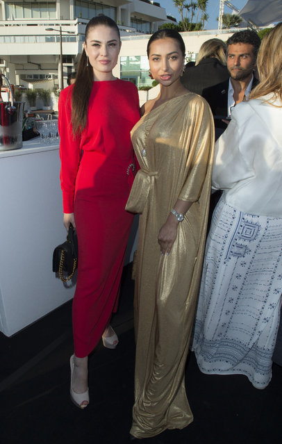 Anastasia Trusova and Golshifteh Farahani attends the Planet Fashion TV and Laurent Perrier Cocktails and Couture Soiree with Transitions Lenses at the 71st international film festival, Cannes, southern France, Saturday, May 12, 2018. (Photo by Planet Fashion TV/AP Images)