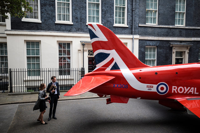 A Royal Air Force Red Arrow jet sits outside Number 10 Downing Street to mark RAF 100 celebrations on May 23, 2018 in London, England. British Prime Minister Theresa May is to hold a reception at Number 10 later today to mark the RAF centenary. (Photo by Jack Taylor/Getty Images)